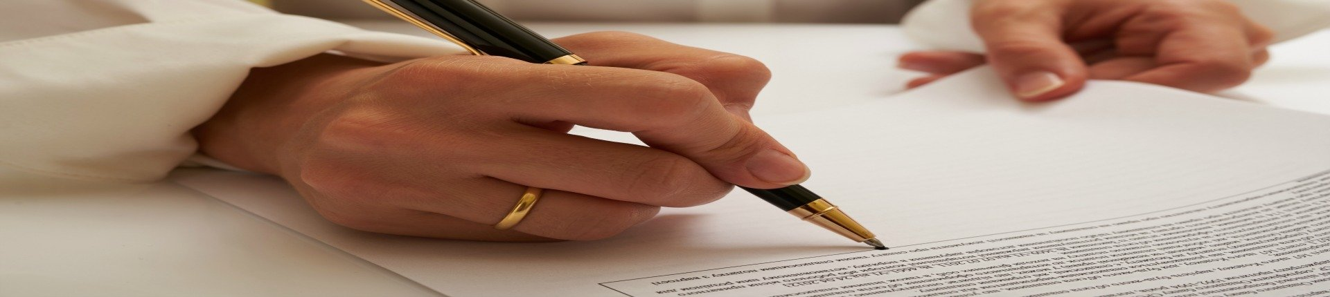 A contract is looked over by a Lorain probate lawyer